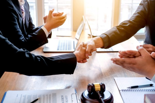 hands shaking after business deal