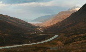 winding road in brown hills