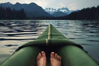 feet in canoe on lake