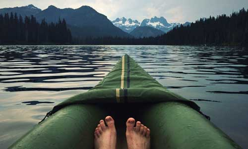 feet in canoe on lake