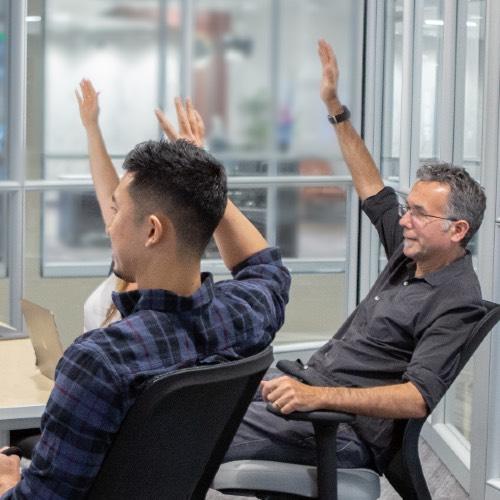 ken and nico raising hands